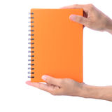 Blank notebook showing by man's hands. Blank orange notebook, with ring spiral, showing by man's hands isolated on white Royalty Free Stock Photos
