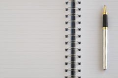 The blank notebook and a silver pen. Royalty Free Stock Images