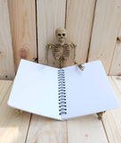 Blank notebook with skeleton human Royalty Free Stock Photo