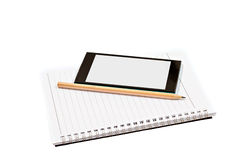 Blank notebook, smartphones and pencil isolated on white Royalty Free Stock Images