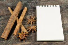 Blank notebook, Star anise and cinnamon. Blank notebook, Star anise and cinnamon on wooden table Royalty Free Stock Photography