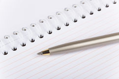 Blank notebook with steel spring and ball pen Royalty Free Stock Photos