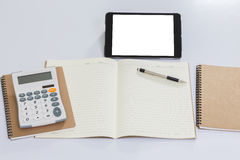 Blank notebook and tablet computer. On white background Stock Photography