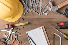 Blank notebook and tools supplies on wood background. Top view. construction industry flat lay concept Royalty Free Stock Image