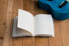 Blank notebook with ukulele guitar Royalty Free Stock Photos