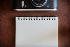 Blank notebook with vintage camera Stock Images