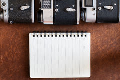 Blank notebook with vintage camera Royalty Free Stock Images