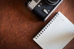 Blank notebook with vintage camera Royalty Free Stock Photography
