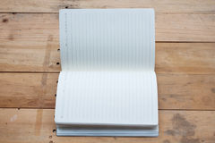 Blank notebook on wood Royalty Free Stock Images