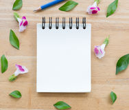Blank notebook on wood background with flowers. Blank notebook for some notes or quotes royalty free stock photography