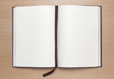 Blank notebook on wood table Stock Image