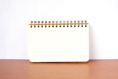 Blank notebook on wood table background, top view Royalty Free Stock Photography