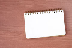 Blank notebook on wood table background, top view Royalty Free Stock Photos