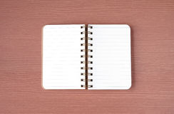 Blank notebook on wood table background,  top view Stock Images