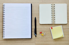 Blank notebook on the wood table - Top view Royalty Free Stock Photos