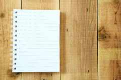 Blank notebook on wooden background. Stock Image
