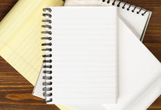 Blank notebook on wooden table Stock Images