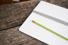 Blank notebook on wooden table, business concept. close up. Blank notebook on wooden table, business concept royalty free stock photos