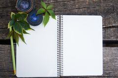 Blank notebook on wooden table, business concept. close up. Blank notebook on wooden table, business concept stock photo