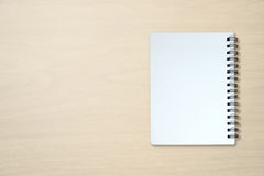 Blank notebook on wooden table Stock Photos
