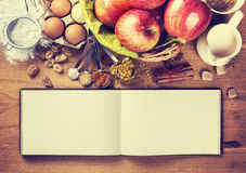 Blank notebook for writing recipes. And ingredients for baking, top view Stock Photography
