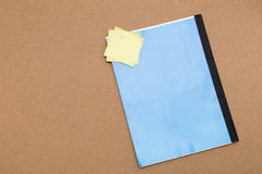 Blank notebook with yellow sticky notes attached. Blue notebook and some yellow sticky notes with free copy space where you can write your message. Everything is stock photo