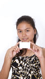 Blank notecard. Portrait of a beautiful young woman holding a blank notecard Stock Photo