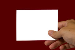 Blank Notecard. On red background with copy space Royalty Free Stock Photo