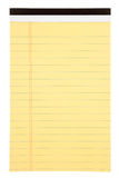 Blank notepad. A blank yellow lined notepad isolated on white Royalty Free Stock Photography
