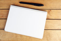 Blank notepad with black pen Stock Image