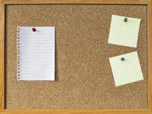 Blank notepad on brown cork board Stock Image