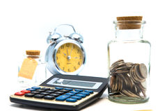 Blank notepad with calculator. Passbook, clock and coins on whit Royalty Free Stock Photography