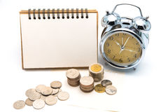 Blank notepad with calculator. Passbook, clock and coins on whit Stock Images