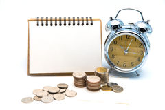 Blank notepad with calculator. Passbook, clock and coins on whit Stock Photography