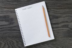 Blank notepad with chequered pages and phrase wish Stock Photos
