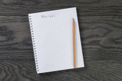 Blank notepad with chequered pages and word recipe Royalty Free Stock Photography