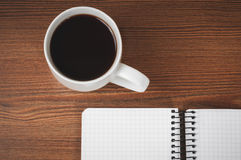 Blank notepad and coffee cup Stock Photo