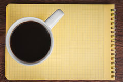 Blank notepad and coffee cup Royalty Free Stock Images