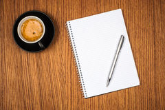 Blank notepad and coffee cup Stock Images