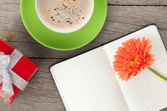 Blank notepad, coffee cup and orange gerbera flower Royalty Free Stock Photos