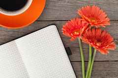 Blank notepad, coffee cup and orange gerbera flowers Royalty Free Stock Photos