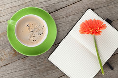Blank notepad, coffee cup and orange gerbera flowers Stock Image