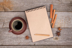 Blank notepad with coffee cup and spices on wooden table Royalty Free Stock Photos