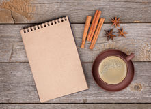 Blank notepad with coffee cup and spices on wooden table Stock Photos
