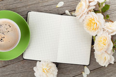 Blank notepad, coffee cup and white rose flowers Royalty Free Stock Images