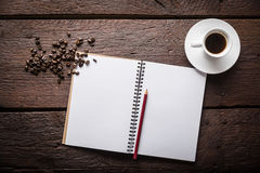 Blank notepad and coffee. Blank, opened notepad, pencil, cup of coffee and beans Royalty Free Stock Image