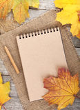 Blank notepad and colorful autumn maple leaves Royalty Free Stock Photo