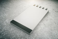 Blank notepad on concrete floor, 3D Render Stock Photos