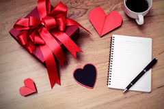 Blank notepad with copy space and red gift box Royalty Free Stock Photo