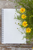 Blank Notepad and flower on wooden table Royalty Free Stock Photography